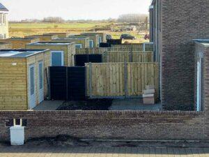 Een nieuwbouwwijk met een RAINWINNER in iedere tuinafscheiding.